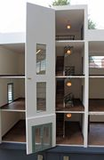 Art Deco dolls house showing central staircase..