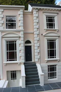 Bespoke Regency dolls house exterior view showing windows with margin lights.