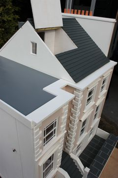 Bespoke Regency dolls house showing flat roof and one side of opening attic.