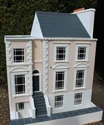 Bespoke Regency dolls house angled view of the front.