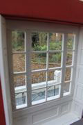 Bespoke Regency dolls house interior view from window reveal with shutters.