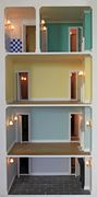 Bespoke Regency dolls house view of interior with rear panel open.
