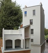 Bespoke Regency dolls house view of back showing cellars and outbuildings.