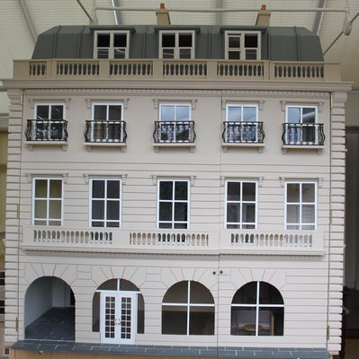 Bespoke grand 1920s dolls house hotel shops wing containing a shop, bar, service tunnel to the kitchen and a Louis XIV suite.