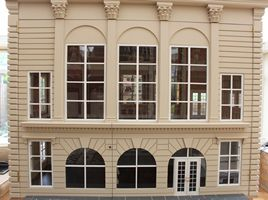 Bespoke grand 1920s dolls house hotel ballroom wing exterior view.
