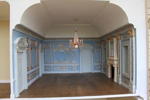 Bespoke grand 1920s dolls house hotel main room in the Louis XIV apartment.