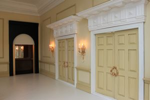 Bespoke grand 1920s dolls house hotel foyer mezzanine with grand double doors leading to the ballroom.