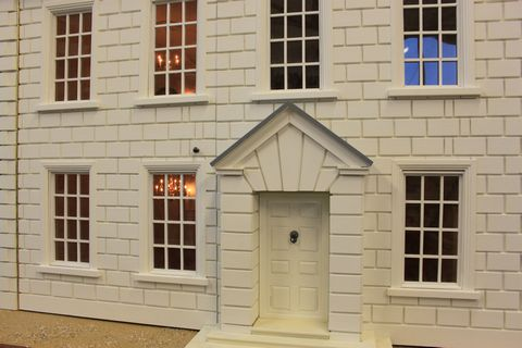 Bespoke Queen Anne style dolls house handmade front door and detail of exterior block-work.