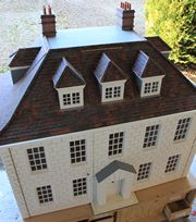 Bespoke Queen Anne style dolls house.