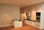 Bespoke Queen Anne style dolls house modern kitchen with recessed spotlights.