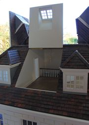 Bespoke Queen Anne style dolls house three panels open in the attic.