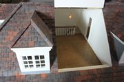 Bespoke Queen Anne style dolls house looking into the attic stairs.