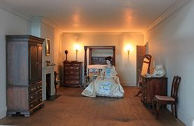 Georgian dolls house bedroom.