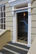 Regency dolls house with open front door.