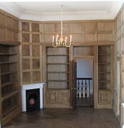 Regency dolls house interior view of panelled library.