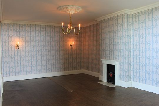 Regency dolls house bedroom with Susan Bembridge wallpaper.