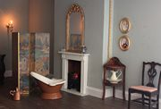 Regency dolls house bedroom with hip bath and wash stand.