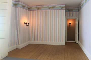 Regency dolls house attic bedroom.