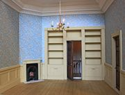 Regency dolls house contemporary library with wallpaper.