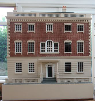 Georgian dolls houses showing brick exterior.