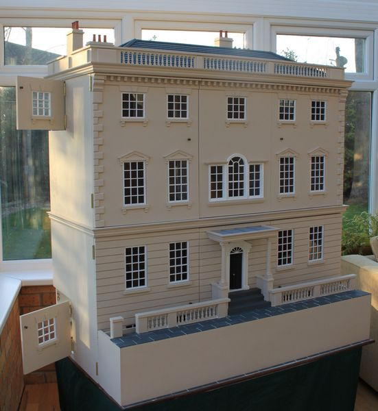 Georgian dolls house with lift-off pavement.