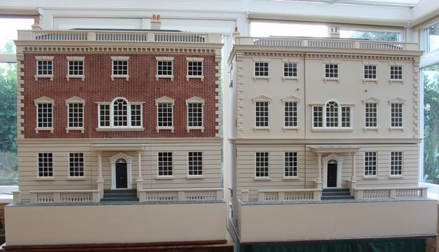 Georgian dolls houses showing brick and plain painted exteriors.