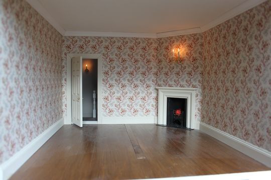 Georgian dolls house bedroom with wallpaper