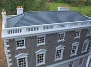 Georgian dolls house with slate hipped roof showing cornice, parapet with balustrade inserts and chimney stacks