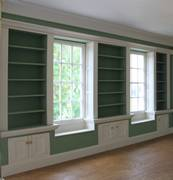 Georgian dolls house Library with window seats and shelves.