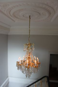 Georgian dolls house grand crystal chandelier set in plasterwork ceiling.