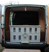 Loading the van for a UK delivery of a dollshouse.