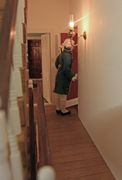 Georgian dolls house furnished interior: Wisbech House footman coming through jib door.